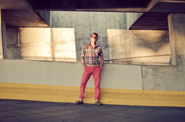 Young stylish man in parking lot with plaid shirt