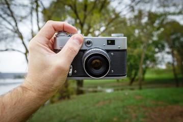 Taking selfie with old vintage camera.