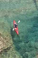 Aerial view of a woman sea kayaker paddling the Turquoise Coast, Turkey.