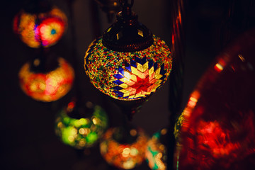 Beautiful Moroccan lamps in the market. Bright oriental background.