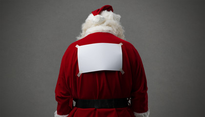 Santa Claus with a blank sign on his back