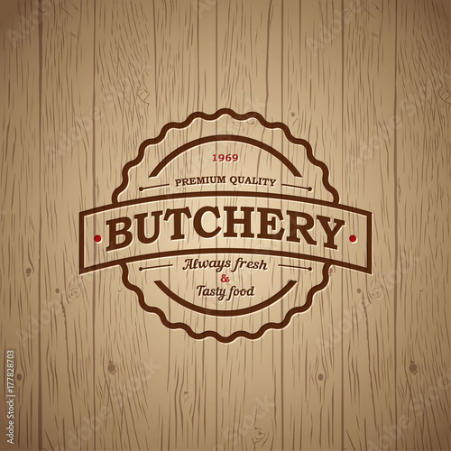 butchery vintage logo embossed logo on vintage wooden background