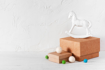 White background with craft gift boxes and toy horse