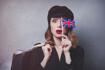girl in hat with shopping bags and flag of United Kingdom