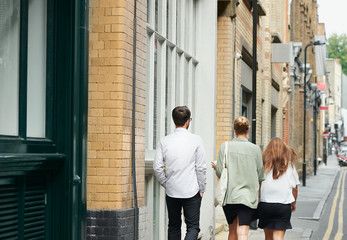 Colleagues walking in the city