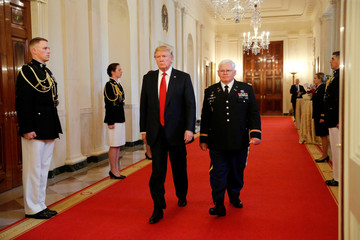Trump presents the Medal of Honor to Rose in the East Room at the White House