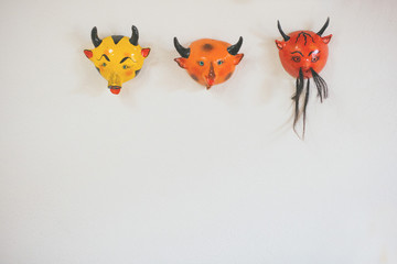 devil masks as wall decor.