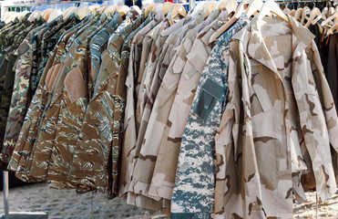 camouflage clothing /Sampling of camouflage jackets in a store