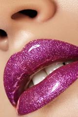 Glamour magenta gloss lip make-up. Fashion makeup beauty shot. Close-up female sexy full lips with celebrate pink gloss