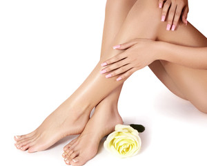 Female legs after depilation. Healthcare, foot care, rutine treatment. Spa and epilation. Feet with clean smooth skin