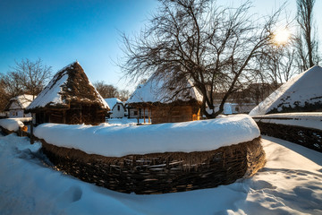 Idyllic rural landscape with traditional cottages in winter at the Village Museum in Bucharest., Romania