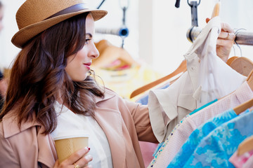 Pretty Woman shopping in cute boutique clothing store