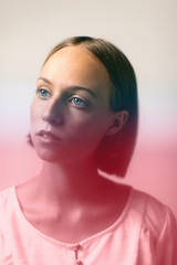 Portrait of a beautiful young woman with a red color effect.