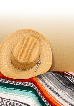Cowboy Hat leaning against Wall with Colorful Blanket