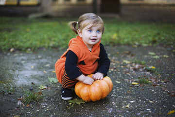 Cute little girl dressed up in a pumpkin halloween costume