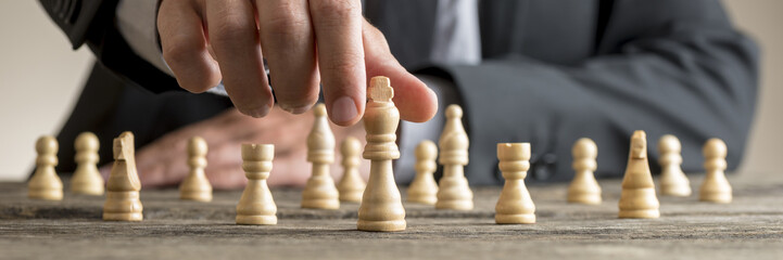 Wide cropped image of a businessman playing chess