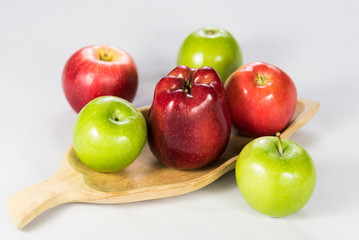 Assorted Apples on Wooden Plate