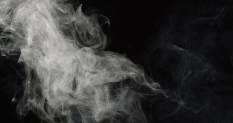 Poster Smoke Wispy tower of smoke on left side of dark background