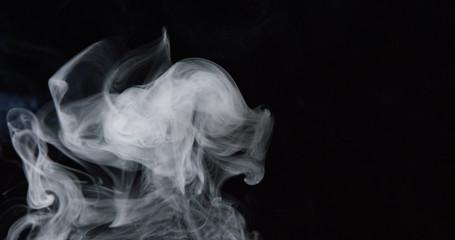 Billowing cloud of white smoke against dark background 2