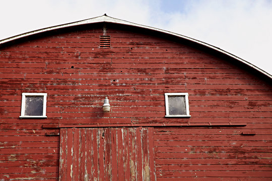 close up photo of old red wooden barn in the country