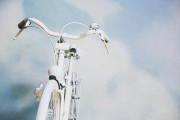 White bicycle against the sky