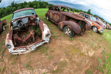 Rusted Old Cars Sit In A Georgia Auto Junkyard