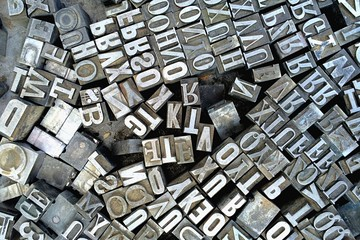 Old antique metal printing letters from a printing press