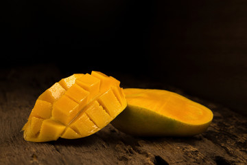 mango on a dark wood background