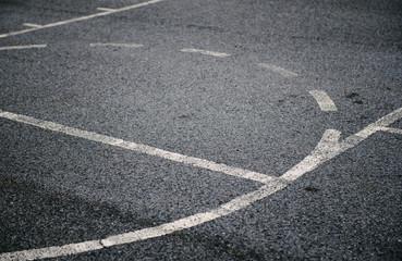 Painted lines on an asphalt basketball court