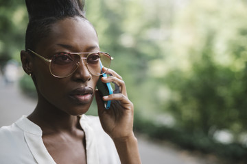 Black businesswoman talking on the phone