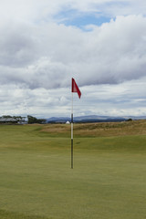 Flagstick on a Scottish golf course