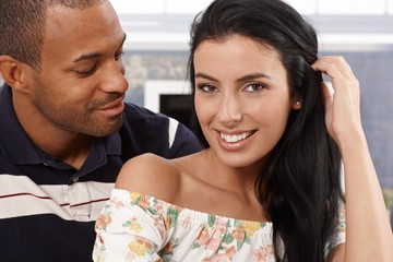Portrait of attractive interracial couple smiling