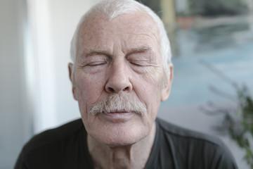 Senior Man with Eyes Closes
