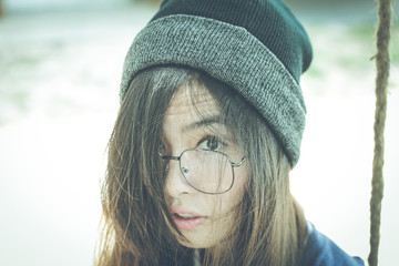 Portrait headshot of Young asian hipster woman wearing glasses