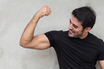 strong healthy indian man muscle posing