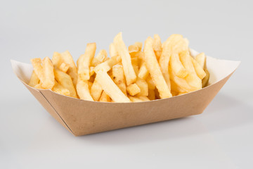 French fries in carton in kraft blank paper fry box on white background isolated