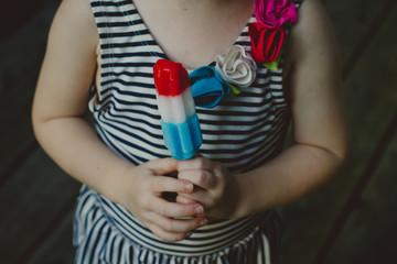 girl holding popsicle