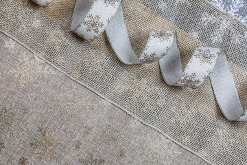 Gold and silver in burlap. Christmas background, top view, flat lay