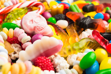 Closeup skull candy with colorful candies for halloween