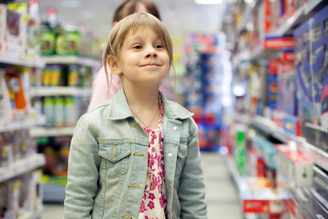 Little girl in   toy store