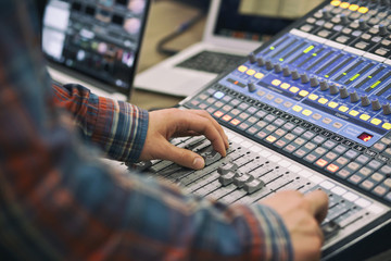 The guy controls the mixing console