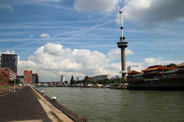 Euromast and Harbor in Rotterdam with blue sky and clouds on background