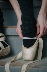 detail of ballet dancer's feet in an urban warehouse setting.