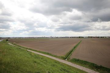 wide overview of the Zuidplaspolder, the lowest area of Netherlands with village Zevenhuizen en Skyline Rotterdam in the background