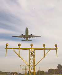 Airplane is landing over landinglights on Rotterdam The Hague Airport