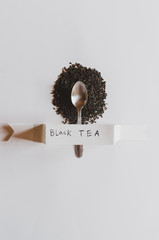 Black tea with spoon and label