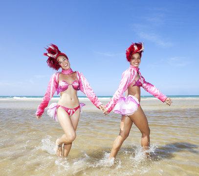 Tropicana dancers walking together near beach. Havana. Cuba