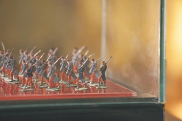 Vintage toy soldiers on a showcase.