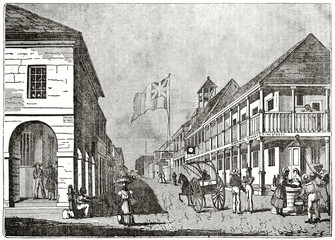 Old grayscale illustration of a typical colonial town. Central perspective. Harbour Street, Kingston, Jamaica. By unidentified author, published on the Penny Magazine, London, 1835