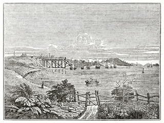 Old grayscale illustration of Tyne river and coal loading pier view. By unidentified author, published on  Penny Magazine, London, 1835